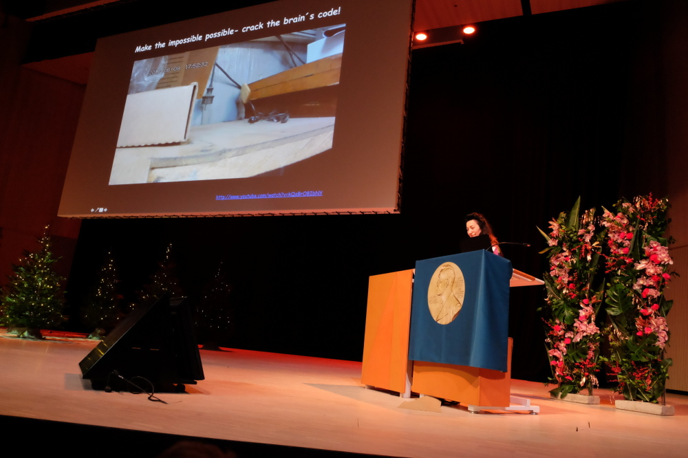 "May-Britt Moser shows a video during her Nobel Lecture on 7 December that illustrates how persistence and determination can make ""the impossible possible."" Photo: Gunnar K. Hansen, NTNU"