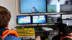Stein Norne, a PhD candidate, and xxxx, control an ROV that is exploring cold water coral reefs that have formed on WWII bombs and other munitions dumped in 600 metres of water at the mouth of Trondheim fjord. Photo: Nancy Bazilchuk