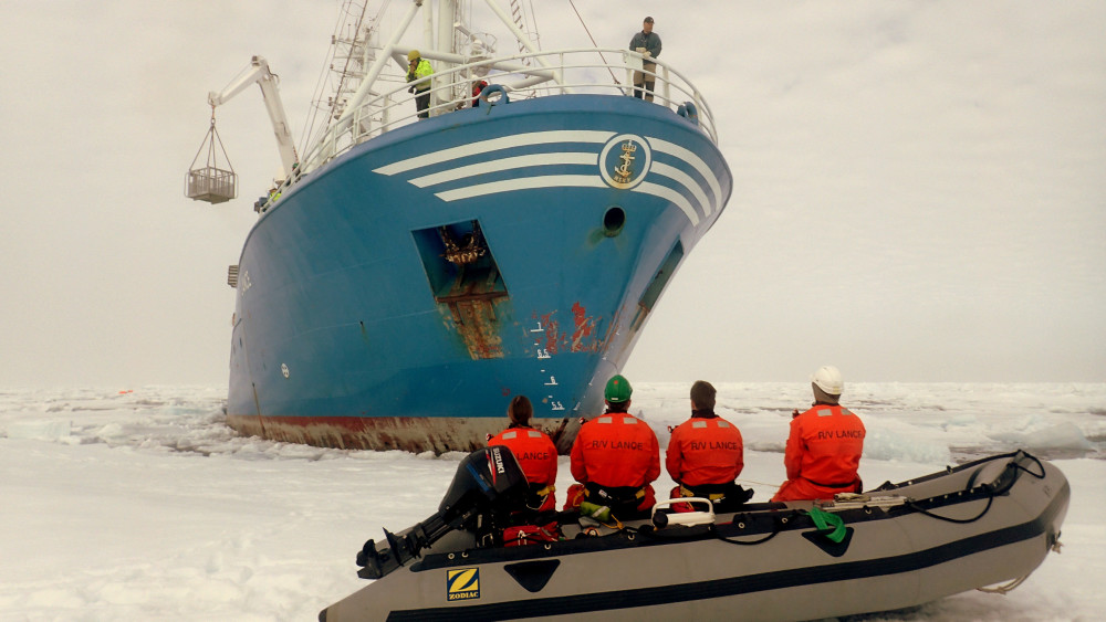 The RV Lance in the ice as researchers head out to make measurements. Photo: A. Shestov