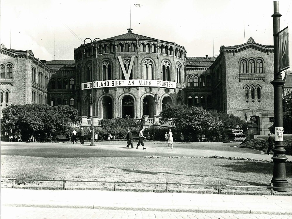 The Norwegian Storting (Parliament) building with a Nazi banner during the German occupation of Norway, 1940-1945. Photo: Courtesy of Riksarkivet, PA-1209/Ue/99/.