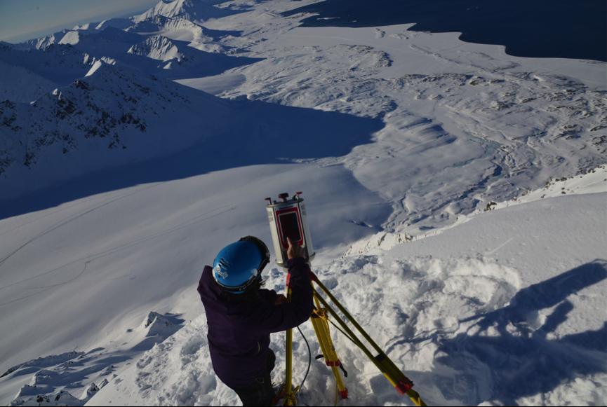 Alexander Prokop uses a terrestrial laser scanner to measure spatial snow depth in Svalbard. Photo: Private