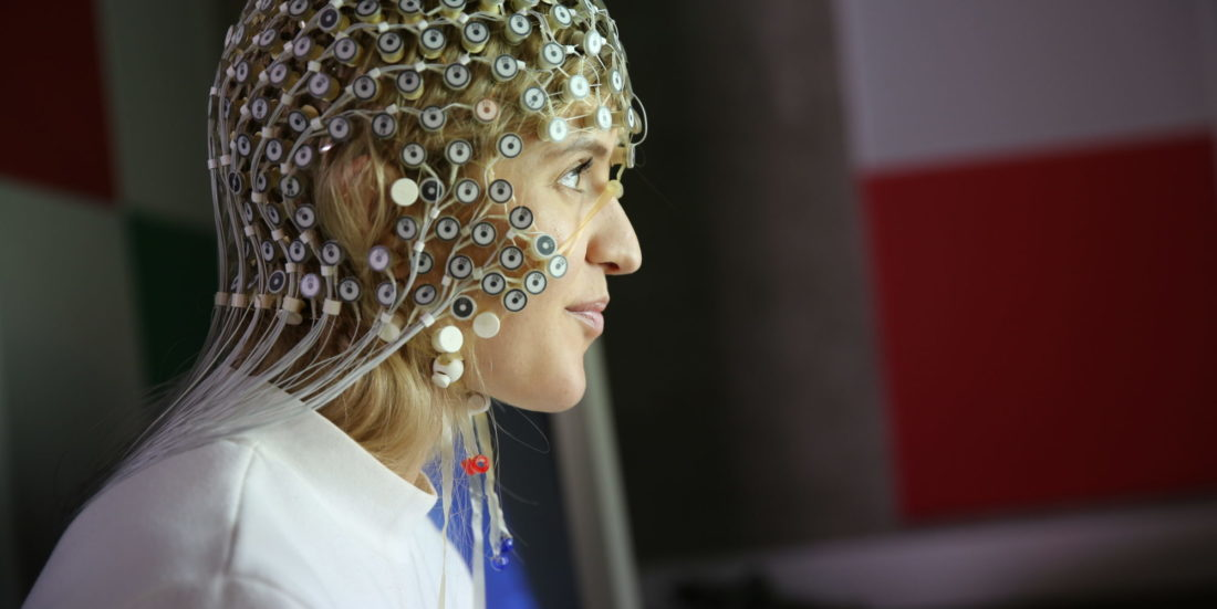 A lady with lots of electrical equipment on her head