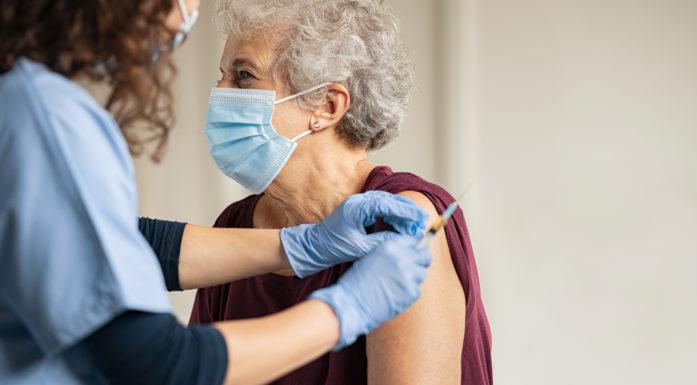 Elderly person getting a vaccine.