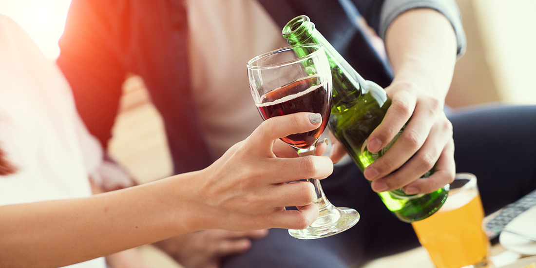 two people having a toast with wine and beer.